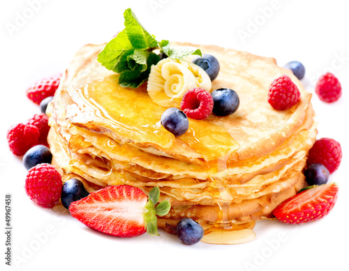 Pancake with Berries. Pancakes Stack over White