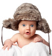 Sweet little baby in a huge fur hat