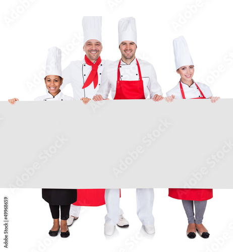 Group of chefs presenting empty banner