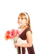 Portrait of little girl with gerberas on a white background