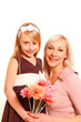 Little girl and woman with flowers on a white background