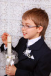 boy going to the first holy communion with candle