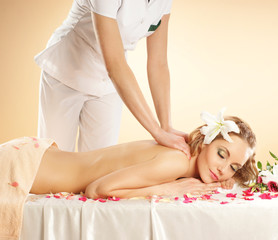 A young woman relaxing on a spa massage procedure