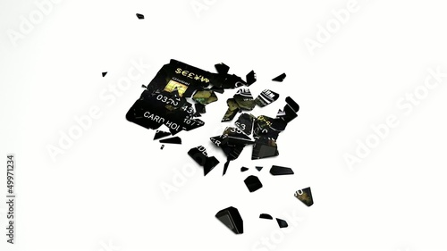 Credit or debit card drops and falls apart.
