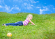 Girl lying on the grass looking to the side