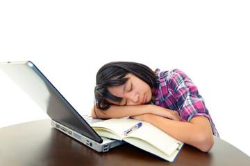 勉強に疲れて眠る女の子
