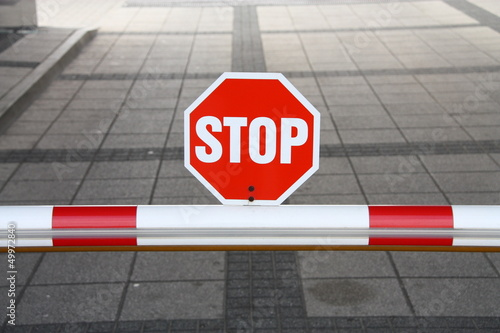 Detail of security barrier with stop sign.