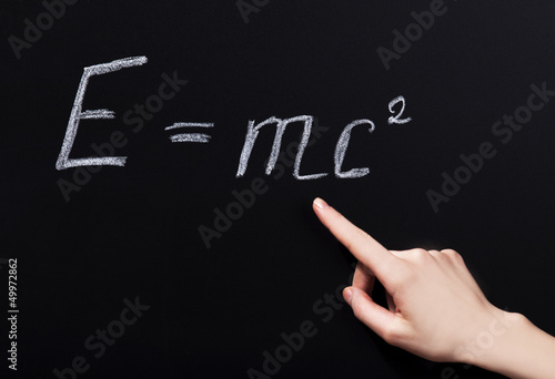 Student hand pointing on phisycs formula.