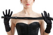 woman in a corset and  whip