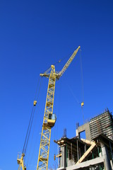 Construction site with yellow crane