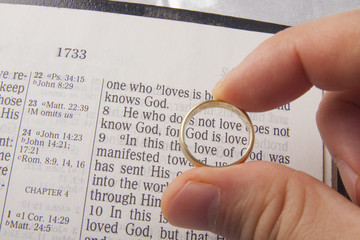 Marriage ring above holy bible