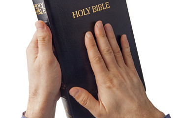 Holy bible in human hands