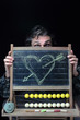 heart hitted by arrow on chalkboard
