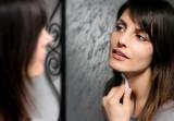 brunette girl cleansing skin face poster