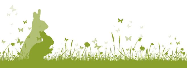 Grüne Osterwiese mit Hasen