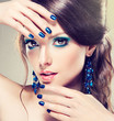 Model with blue make-up and manicure