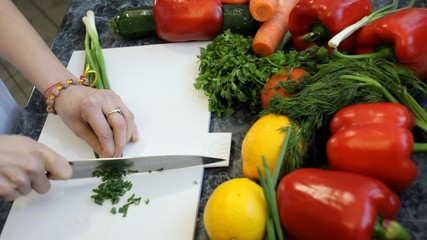 slicing chives with a knife chef