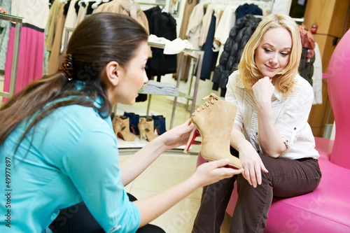 woman and assistant at shoe shopping