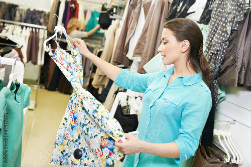 Young woman at clothes shopping