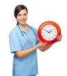 Smiling doctor with clock