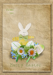 Happy Easter card with eggs and bunny on a vintage background