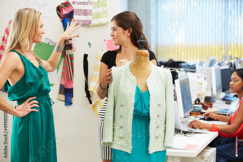 Two Women Meeting In Fashion Design Studio