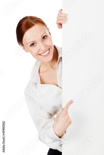 Happy smiling young business woman with a blank signboard