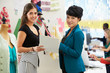 Two Women Meeting In Fashion Design Studio