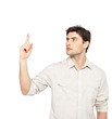 Young serious man points with finger up