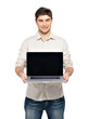 man holds laptop with blank screen