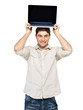 smiling happy man with laptop on head