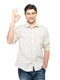 Young happy man with ok sign