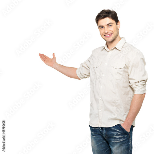 Young man shows  something isolated on white