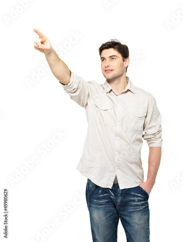 smiling man points with finger on something