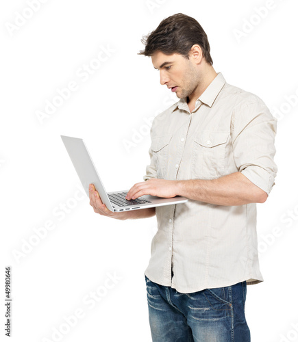 Portrait of young man with laptop  in casuals