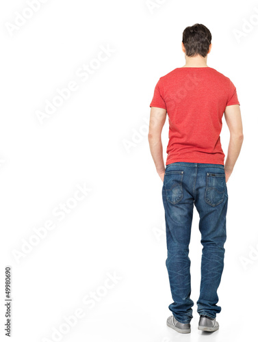 portrait of man standing back in casuals