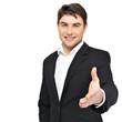 Smiling businessman in black suit gives handshake
