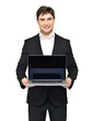 happy businessman holds the  laptop