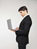 businessman working on laptop  in black suit