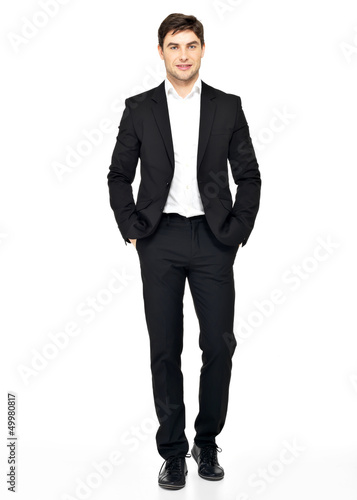 Portrait of smiling businessman in black suit