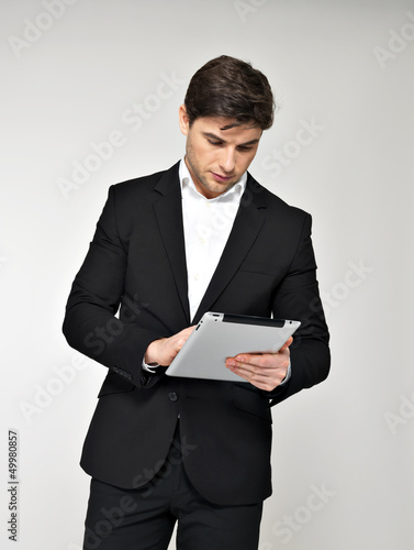 businessman in black suit with pad at studio