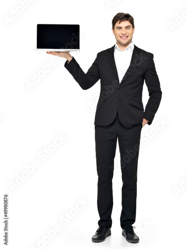 businessman holds on palm the opened  laptop
