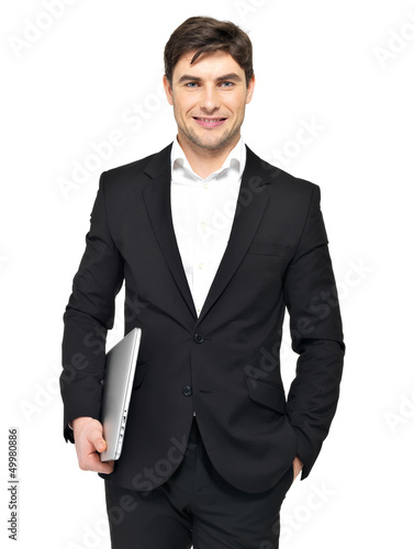 Portrait of young happy businessman holds laptop