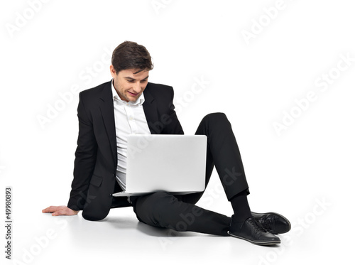young happy businessman working on laptop