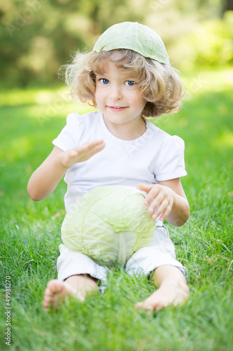 Child with white cabbage
