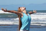 girl enjoying sun at the beach