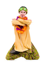 man doing yoga exercise in pose of lotus