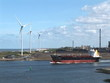 The Industrial Port Of Ijmuiden- Cargo Ship And Wind Turbines