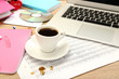 Cup of coffee on office desktop close-up