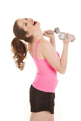 Woman in pink tank weights head back
